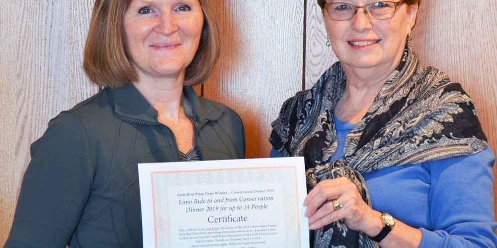 Ann Johns receives winning certificate from Judith Parker