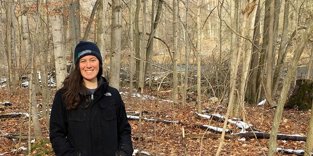 Tallula Ash, Ausable Bayfield Conservation staff member, at local woodlot.